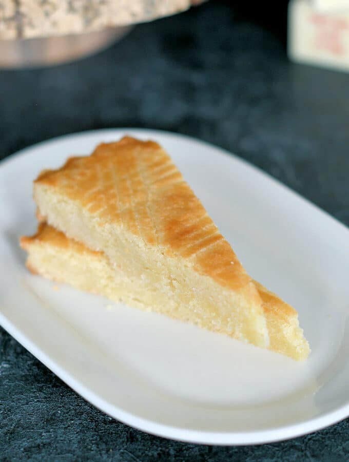 two slices of dutch boterkoek on a white plate