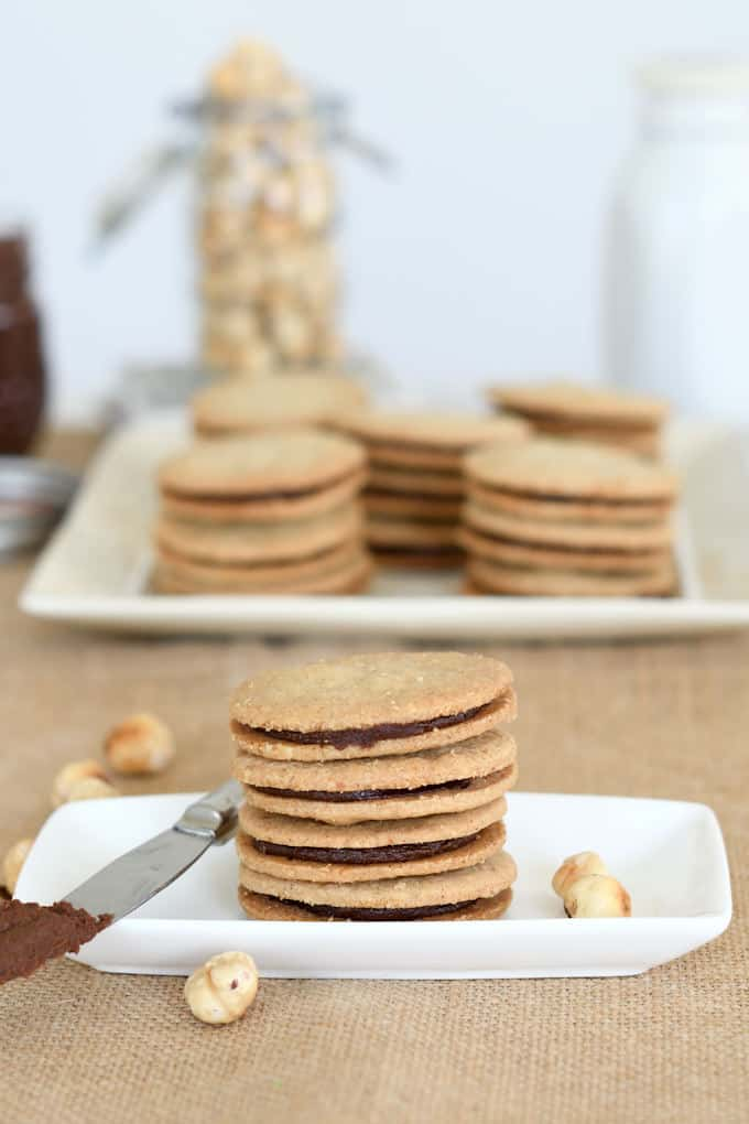 a stack of nutella sandwich cookies on a white plate