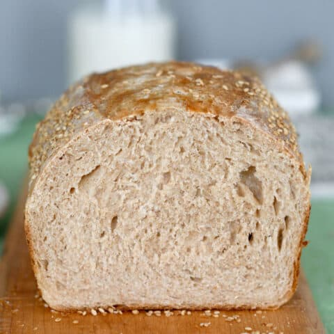 a closeup shot of a loaf of sourdough whole wheat bread