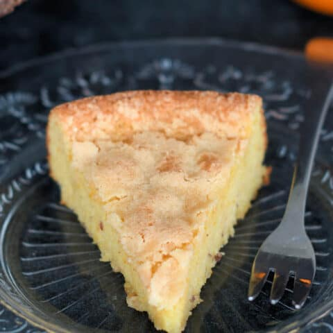 a slice of flourless almond cake on a plate