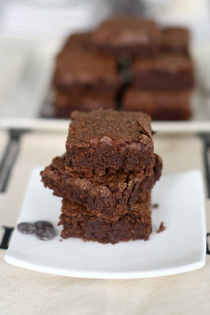 a stack of sourdough brownies on a white plate