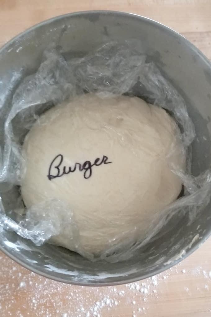 a bowl of sourdough hamburger bun dough