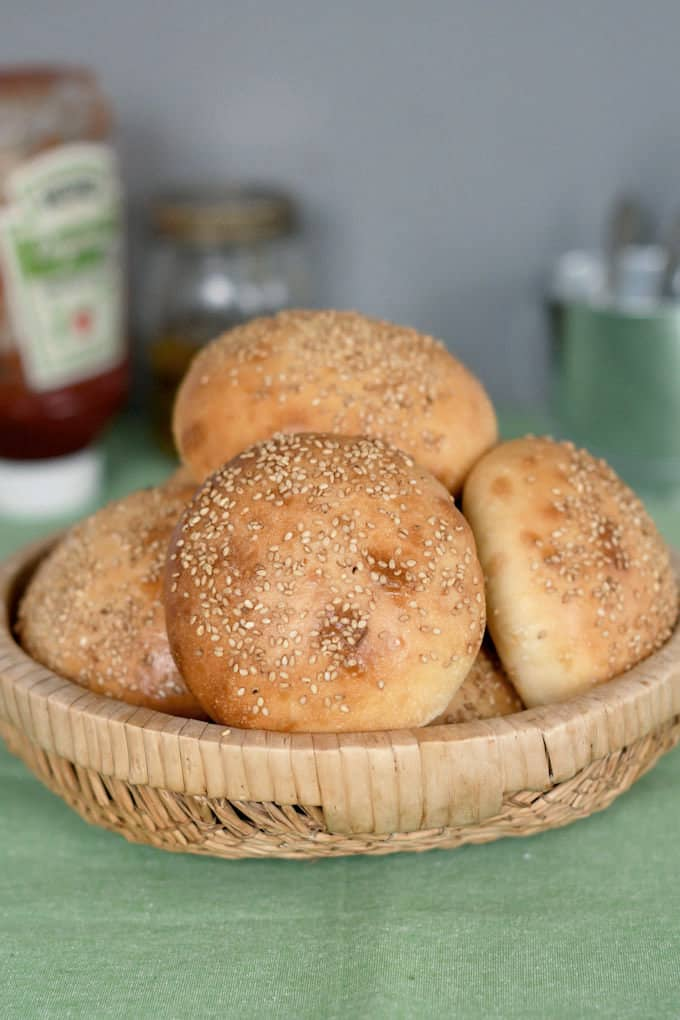 a basket of sourdough hamburger buns