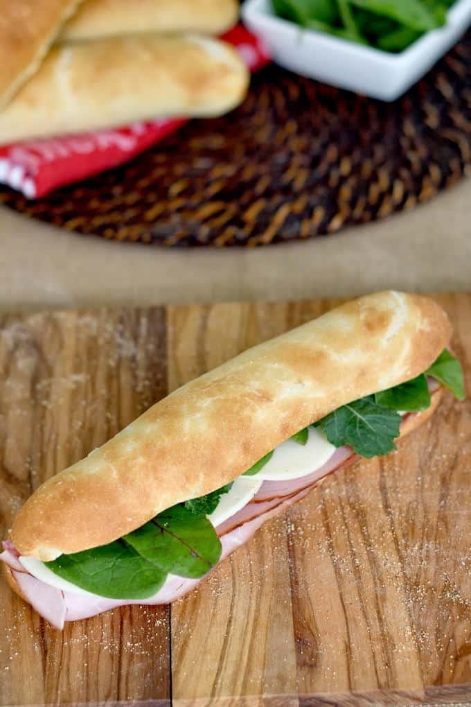 a submarine sandwich on a cutting board