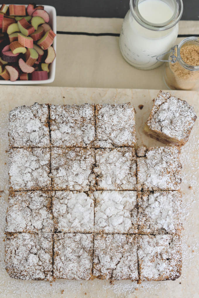 an overhead view of a crumb cake sprinkled with powdered sugar