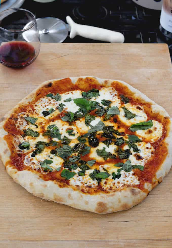 a pizza on a wooden cutting board