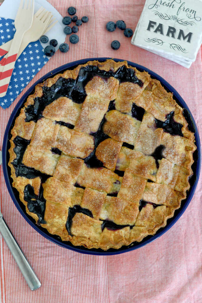 top view of a blueberry pie with a lattice crust