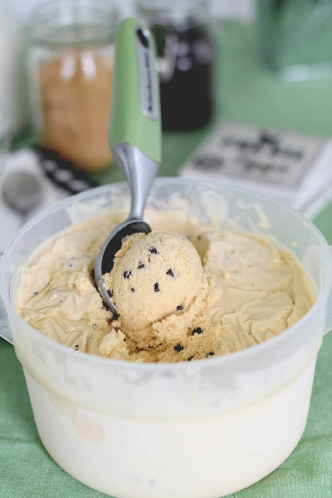 a bin of homemade cookie dough ice cream with a scoop