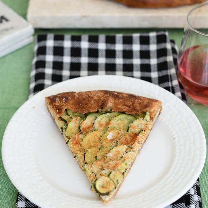 a slice of zucchini galette on a white plate