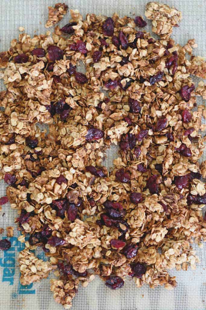 a tray of chunky granola with walnuts and cranberries