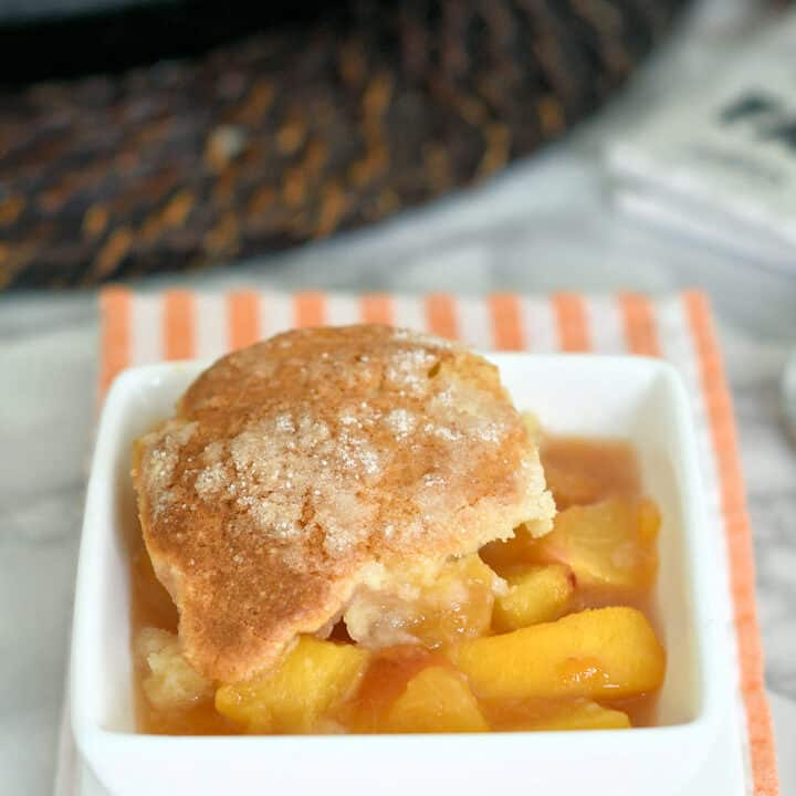 a bowl of peach cobbler