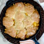 a pinterest image for fresh peach cobbler with text overlay