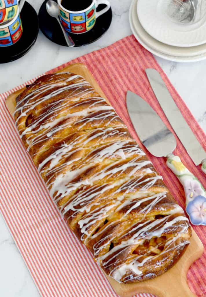 overview shot of an apple danish braid with icing drizzle