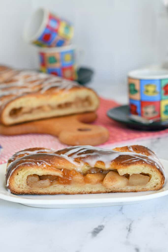 a slice of apple danish pastry on a plate