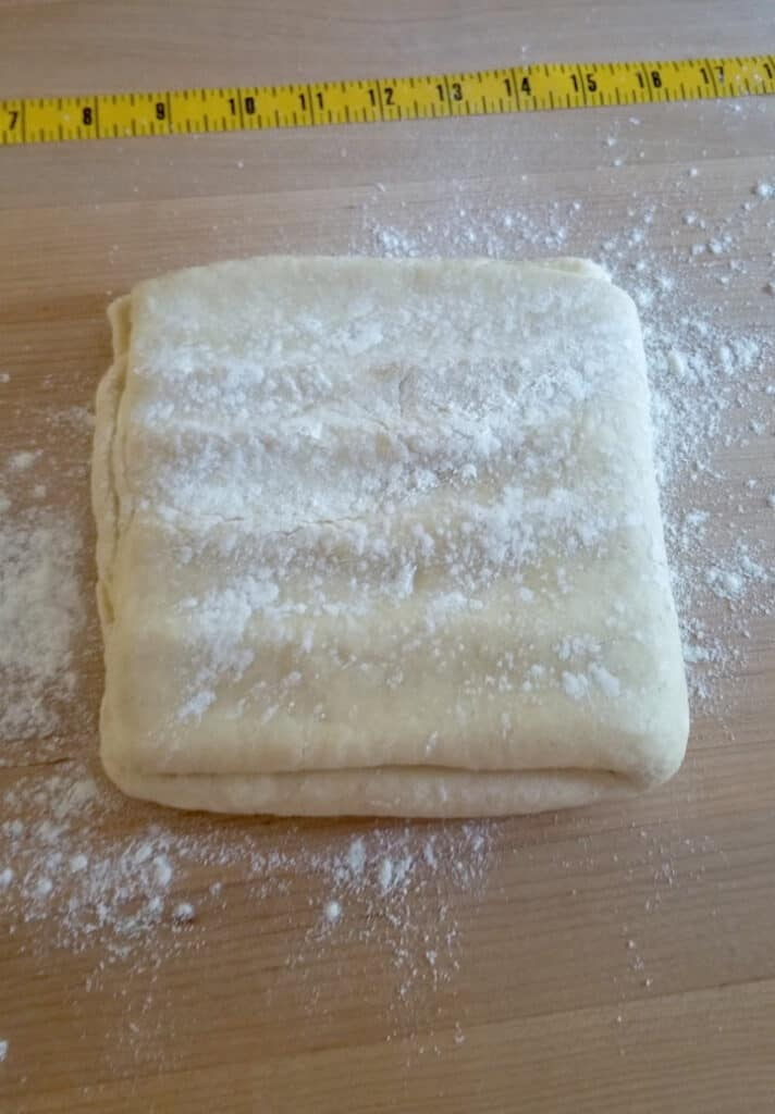 a slab of danish pastry dough ready for rolling