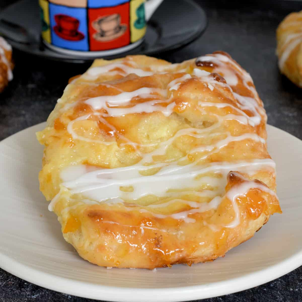 two homemade cheese danish on a plate