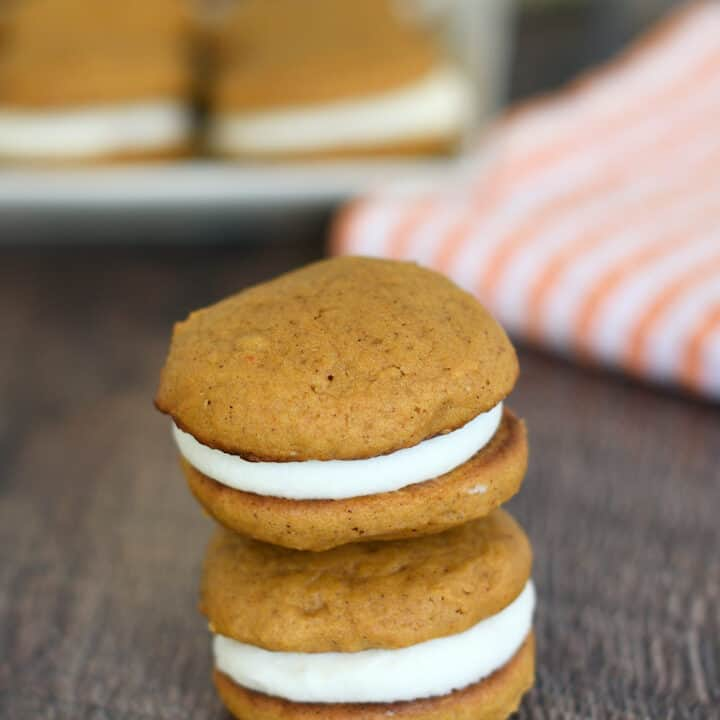 two pumpkin whoopie pies stacked on a table