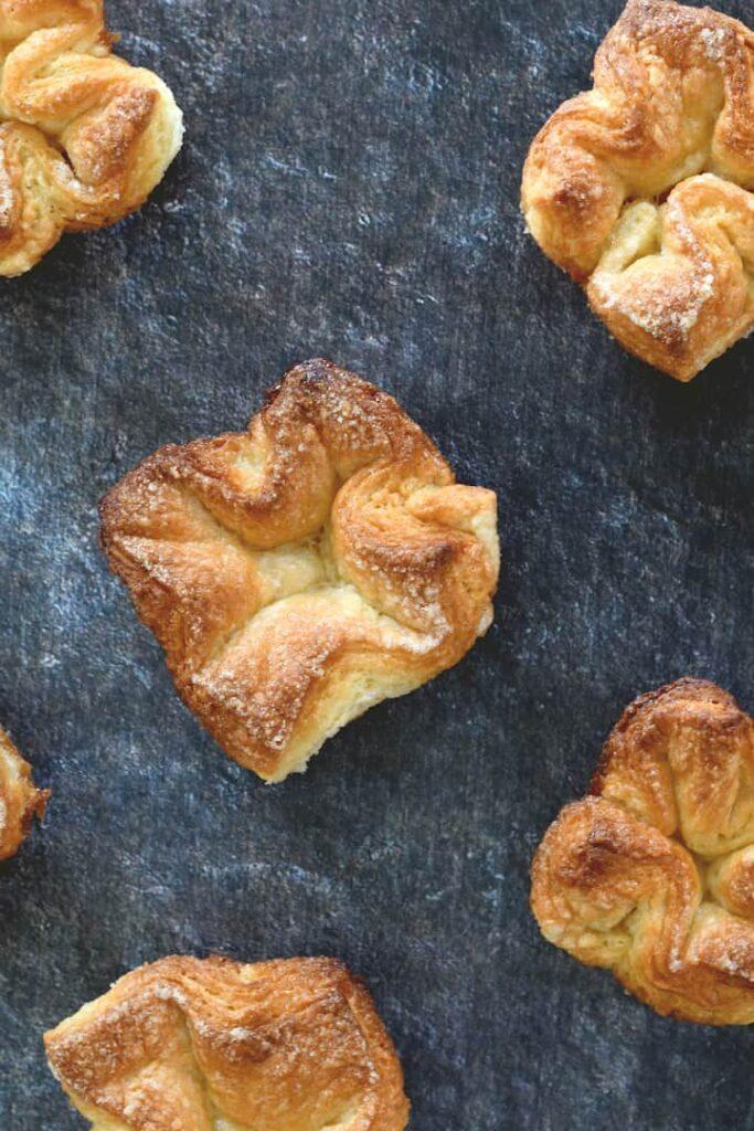 an overhead shot of several sourdough kougin-amann pastries