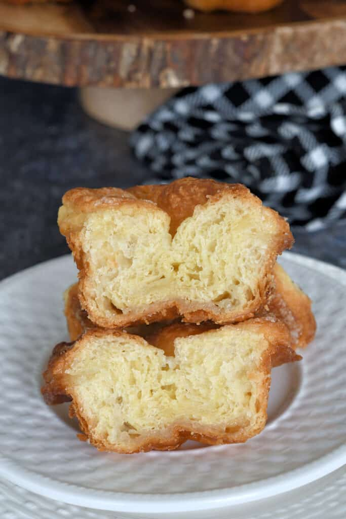 a split kouign amann on a plate showing the buttery layers