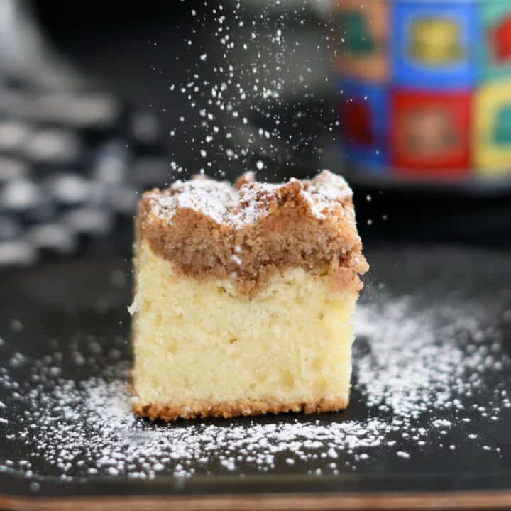 a slice of sourdough crumb cake on a plate