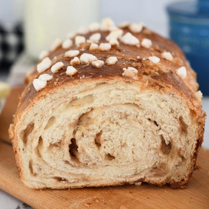 a sliced dutch sugar bread on a cutting board