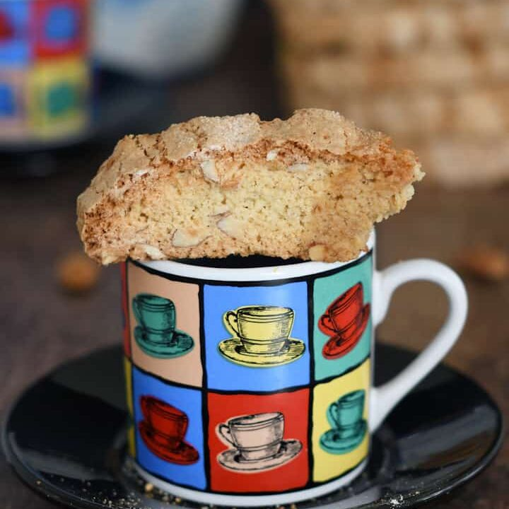 a sourdough biscotti on a cup of expresso