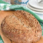 a pinterest image for sourdough cracked wheat bread with text overlay