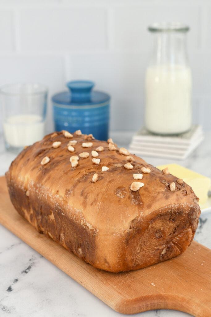 a loaf of dutch sugar bread on a cutting board