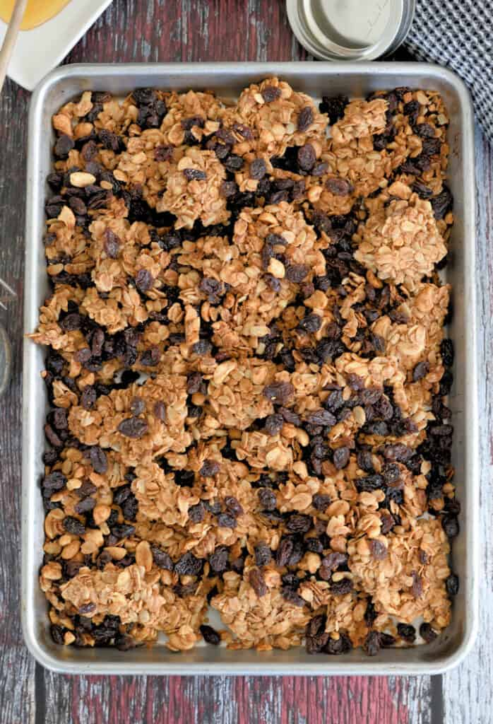 a tray of peanut butter granola with raisins