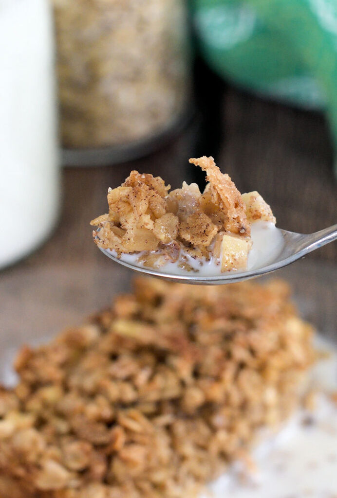 a spoonful of apple maple baked oatmeal with milk