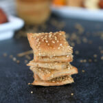 a stack of sourdough crackers with sesame seeds