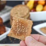 a pinterest image for whole wheat sourdough crackers with text overlay