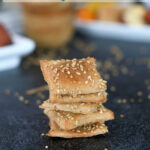 a pinterest image for sourdough whole wheat crackers with text overlay