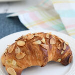 a pinterest image for homemade almond croissants with text overlay