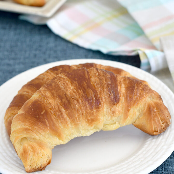 a croissant on a plate