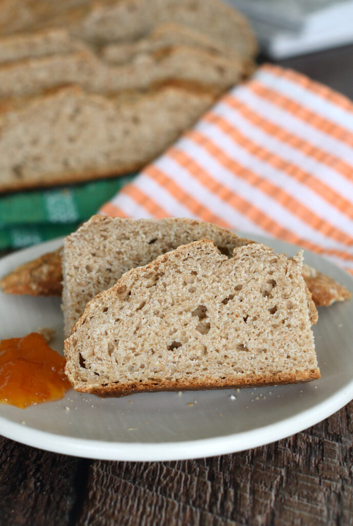 a piece of irish brown bread on a plate with marmalade