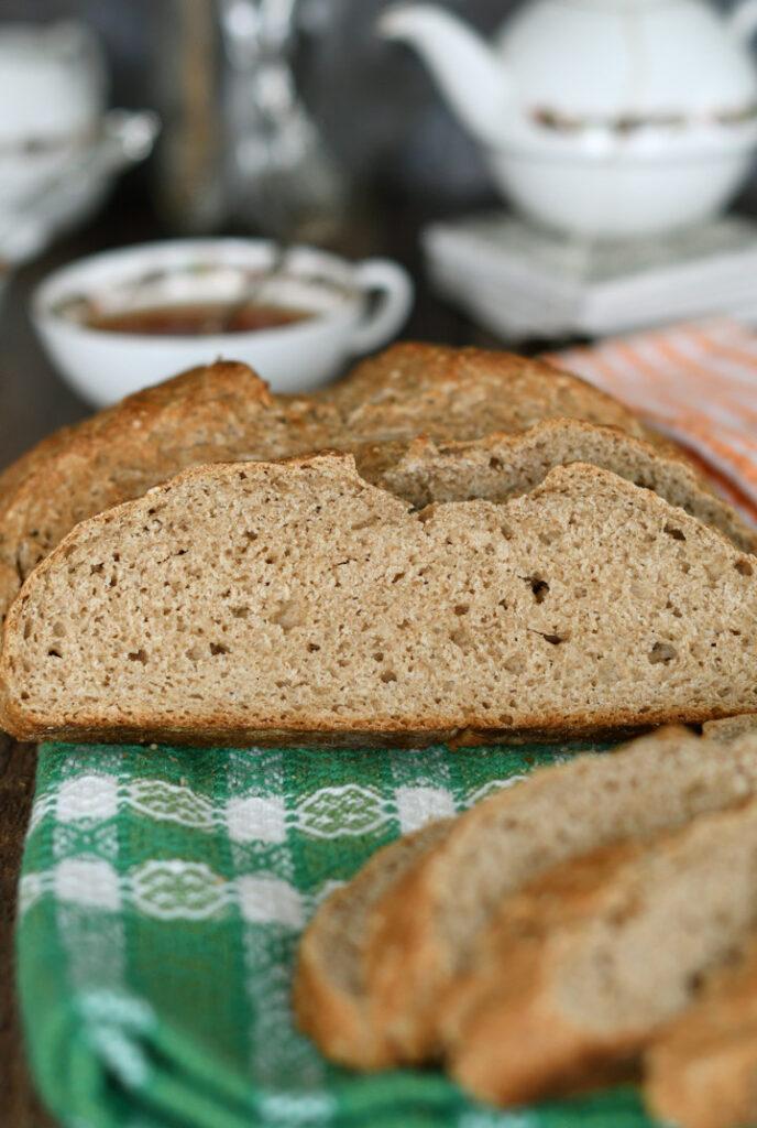 a slice of irish brown bread on a green towel