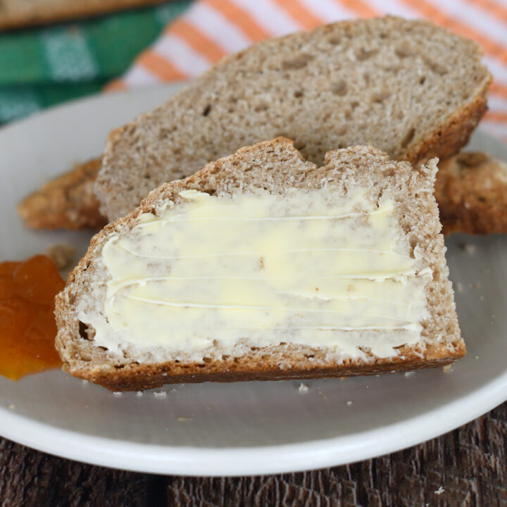 a slice of irish brown bread with butter on a plate