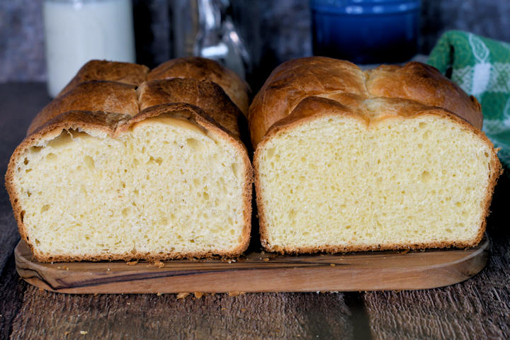 a loaf of sourdough brioche next to a loaf of classic brioche. Showing the difference in texture.