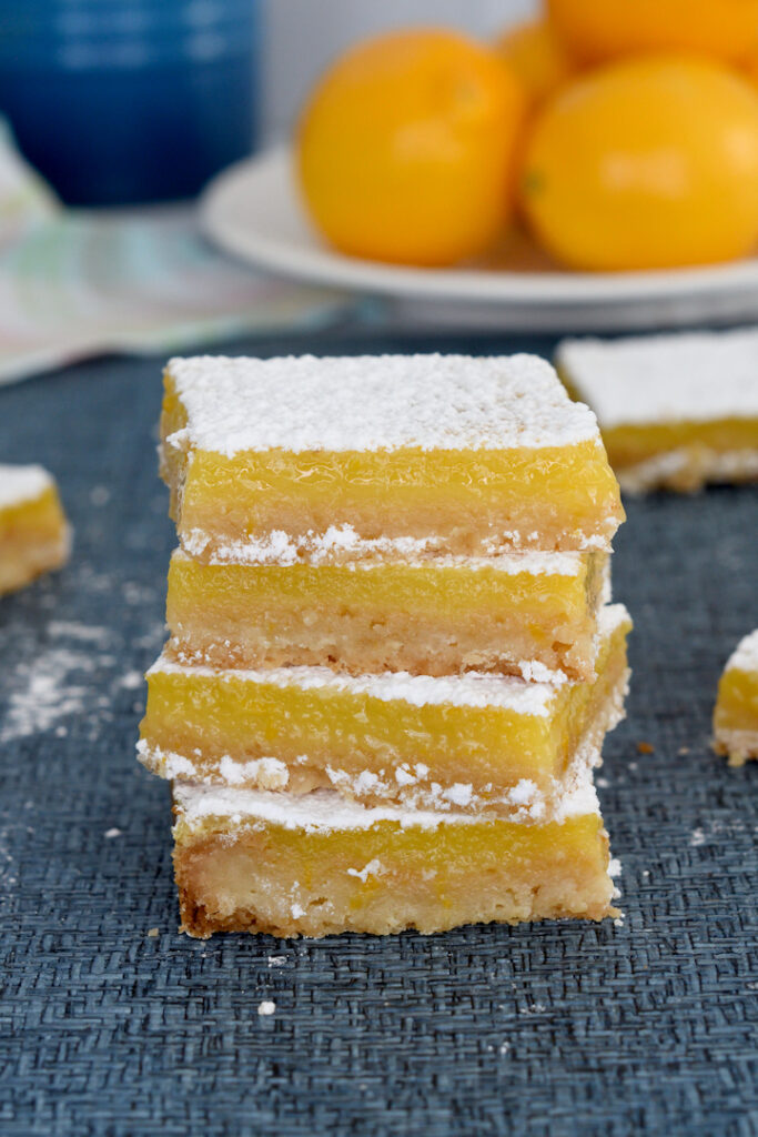 a stack of meyer lemon bars