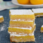 a pinterest image for meyer lemon bars with text overlay