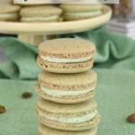 pinterest image for pistachio macarons with text overlay