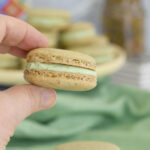 a pinterest image for pistachio macarons with text overlay