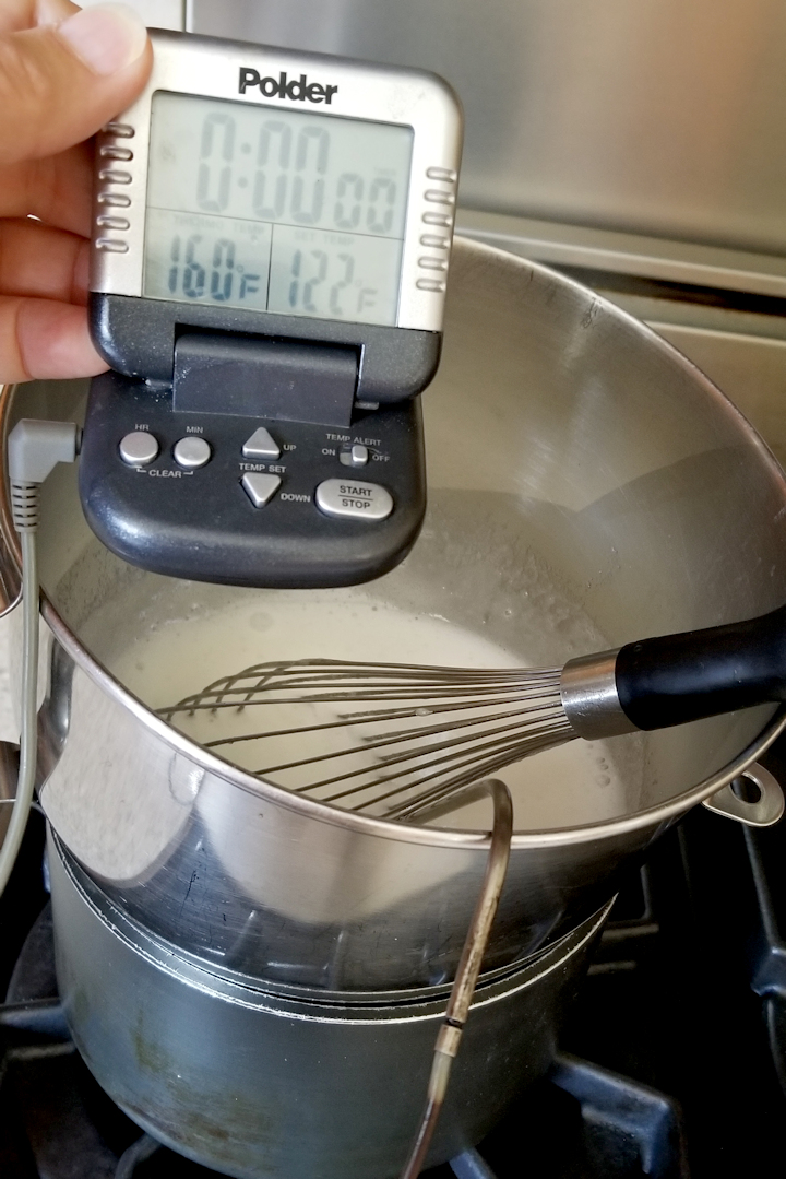 showing how to cook 7 minute frosting over simmering water