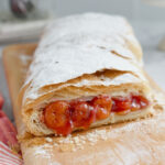 a pinterest image for cherry strudel with text overlay