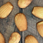 a pinterest image for french madeleines with text overlay