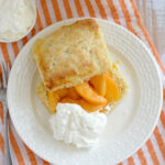 a pinterest image for peach shortcake with text overlay