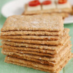 a pinterest image for sourdough oatmeal cripsbread with text overlay