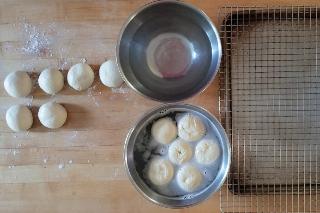 showing the setup for dipping pretzel roll dough
